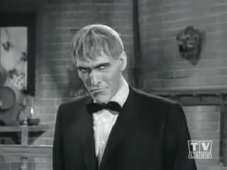 Lurch in Addams Family episode posing for his album cover