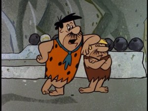 Fred and Barney wearing broom-bristle mustaches
