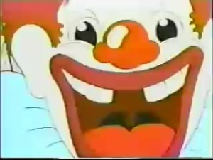 Clown approaching camera in extreme closeup